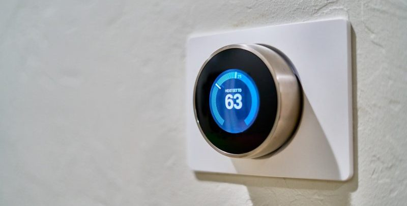 thermostat set to 63 degrees