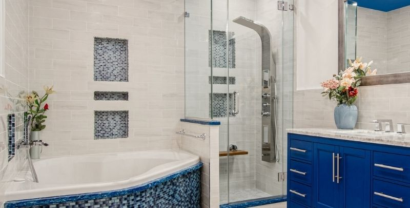 panel shower head in white and blue bathroom